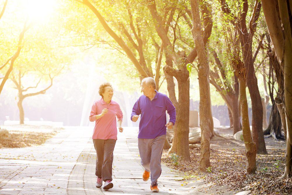 senior couple enjoying a brisk walk through the park