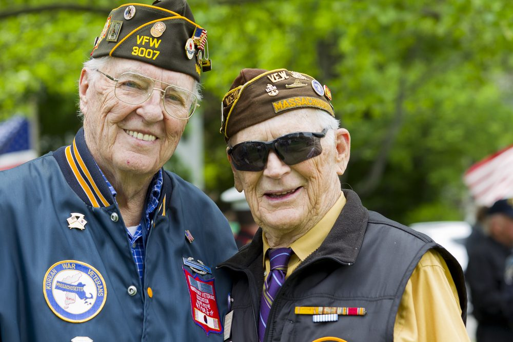 Two older veterans, smiling