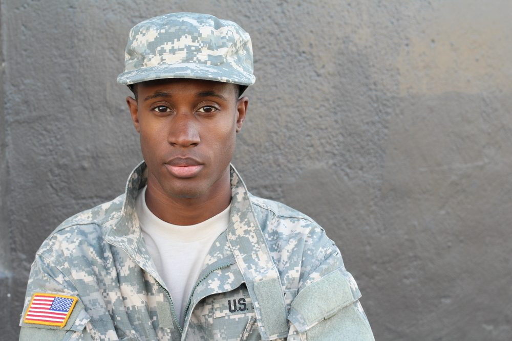 African American soldier staring solemnly toward the camera