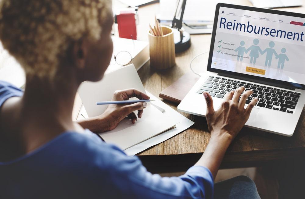 Woman applying for reimbursement on computer