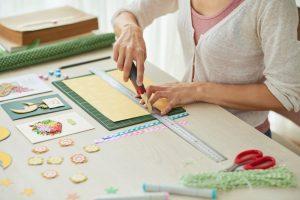 Woman creating scrapbook