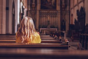 Woman sitting in church pew
