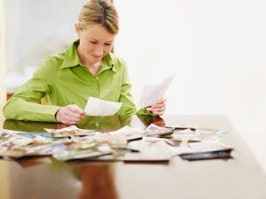 Woman sitting at table selecting photos