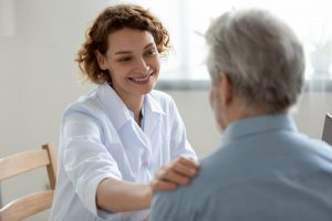 Doctor placing comforting hand on patient's shoulder