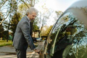 Man in suit opening car door
