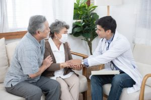 Illustrates doctor talking with older couple about care options