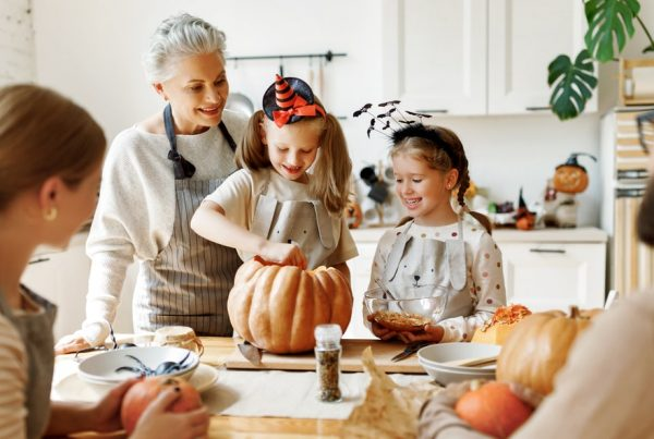 Shows family and grandmother at a Halloween family gathering