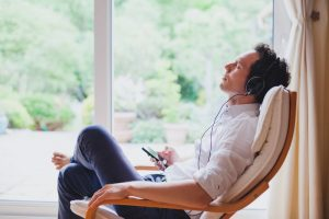 to show a man listening to music and remembering a loved one