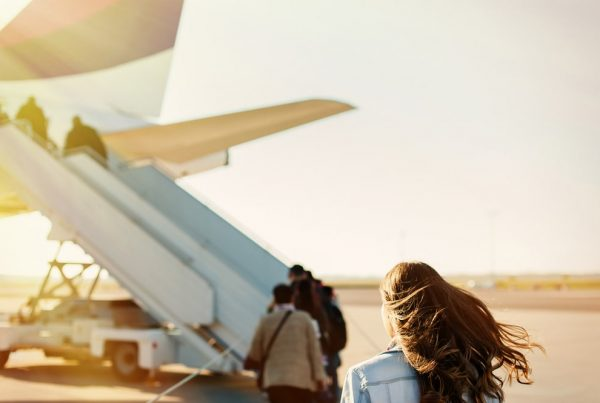 Shows people boarding a plane with sunlight on their hair