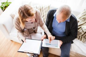 Nurse reviewing paperwork and options with male patient
